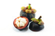 Mangosteen and cross section showing the thick purple skin and w