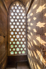 Qutb Minar, Delhi, carvings in the sandstone of a window gives a