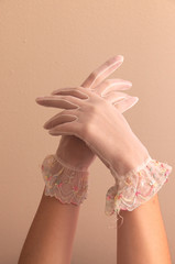 female hands modeling vintage lace gloves