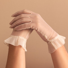 female hands modeling vintage sheer gloves