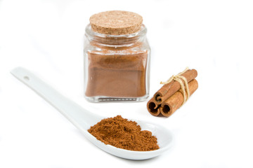 Cinnamon on a spoon and a bottle