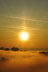 beautiful sunrise and covered by fog landscape