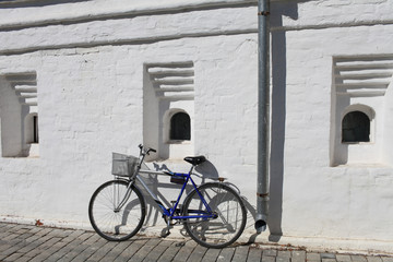 road Bicycle leaning against a white wall