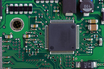 Green computer board with chips and components.