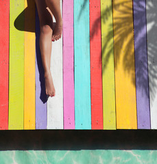 Woman on a colorful wooden pier background holiday concept