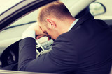 Fototapety tired businessman or taxi car driver