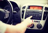 Fototapety man using car audio stereo system