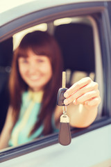 happy woman holding car key