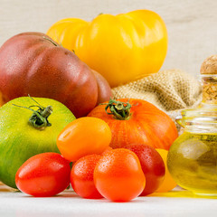 Varieties of colorful tomatos and olive oil