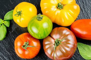 Many varieties of colorful tomatos