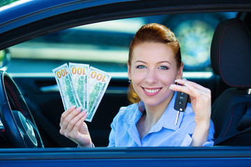 Excited young woman bought new car, showing keys, money