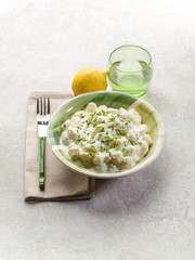 gnocchi with chive cream sauce and grated lemon