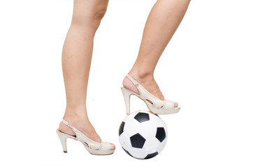 Woman feet  stand on the ball with hight hill