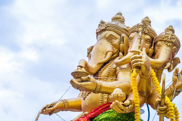 The statute Ganesha outdoor against blue sky and white clouds