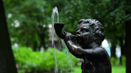 Fountain boy blows a horn