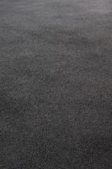 Hintergrund trockener Asphalt im Gegenlicht