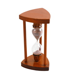 ancient wooden hourglass over white
