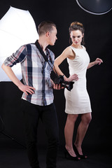 Photographer giving advice to female model