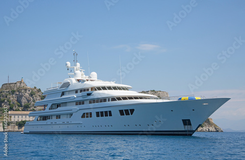 Luxury large super or mega motor yacht in the blue sea. - 66730363