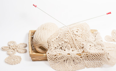 skeins needles and knitted fabric