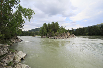 Island in the middle of a mountain river Katun.