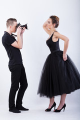 Side view of a photographer and female model