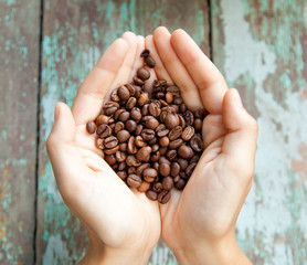 coffee beans in the hands of the human
