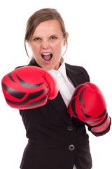 Young businesswoman with boxing gloves punching ready to fight,