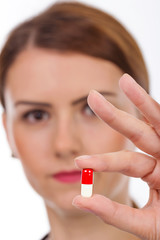 Female doctor holding pill