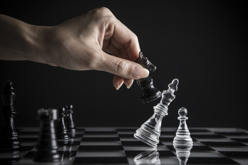 chess pieces and  hand