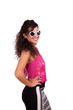 Happy young woman wearing sunglasses and posing