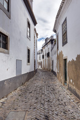Old, historical street of Faro city in Portugal
