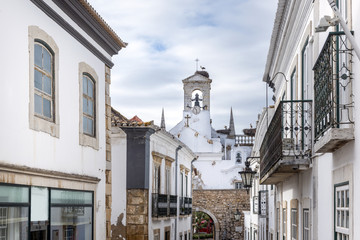 Church tower in historic district of Faro, Portugal