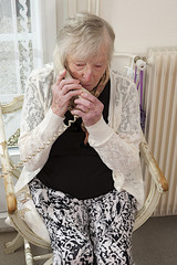 senior woman calling on phone at home