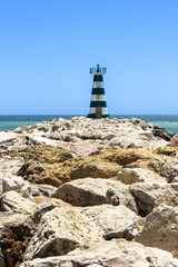 Lonely lighthouse on Portugise coastline