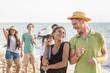 Obrazy na płótnie, fototapety, zdjęcia, fotoobrazy drukowane : Multiracial Group of Friends Having a Party at Beach