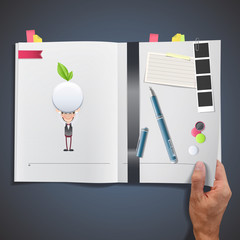 Business people with ecologic white button printed on book