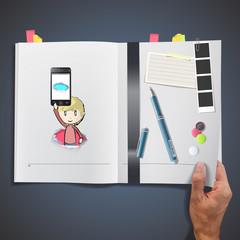 Kid holding Phones printed on book