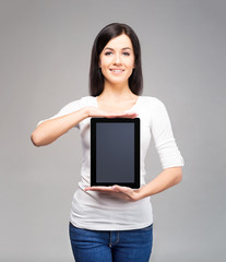 Young and beautiful teenager girl holding an ipad