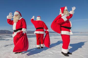 Three  Santa Claus outdoors