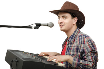 Young cowboy creates western music