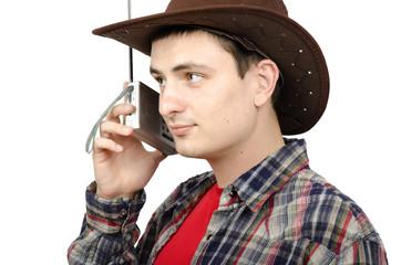 Cowboy listening weather forecast on the radio