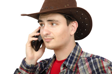 Puzzled paleface cowboy talking on smartphone