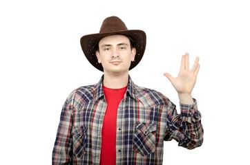 Young cowboy showing Vulcan salute