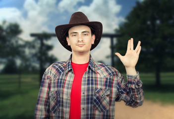 Paleface young cowboy showing Spoke sign