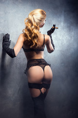 Young and beautiful cabaret dancer in sexy lingerie