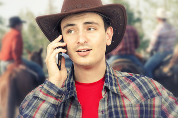 Ironic little smile of cowboy lips calling on phone