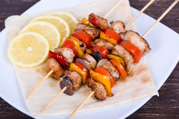 Tasty grilled meat and vegetables on skewer