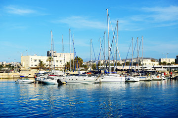 The yachts and motor boats are near pier, Crete, Greece