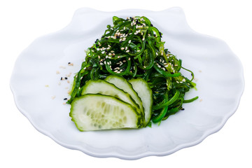 Seaweed salad with cucumber on the plate